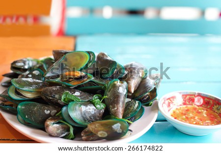 Steamed mussels with sweet basil and chilli sauce in Thai style - stock photo