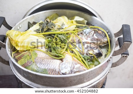 Steamed Nile tilapia fish and vegetables,Thai style food