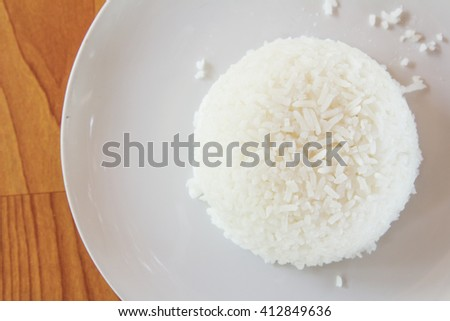 Steamed rice on white plate close up.