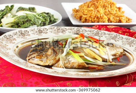 Steamed sea bass for Chinese New Year meal - stock photo
