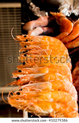 Steamed shrimp arranged on a plate - stock photo