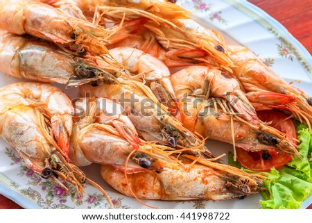 steamed shrimp/prawn in the white plate ready to eat - stock photo