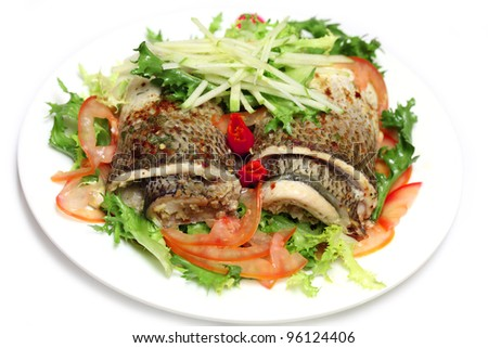 Steamed spicy whitefish salad with chicory lettuce and tomato - stock photo