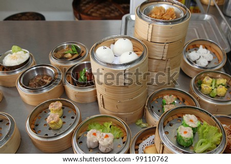 Steamed stuff bun and many chinese steamed dimsum in bamboo containers traditional cuisine.