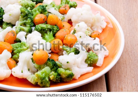 steamed vegetables / broccoli,carrot and cauliflower - stock photo