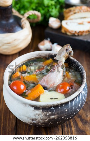 Steamed vegetables with chicken in a ceramic pot - stock photo