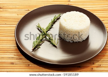 Steamed white rice on a  brown plate. - stock photo