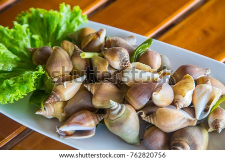 Steamed wing shell with spicy seafood sauce