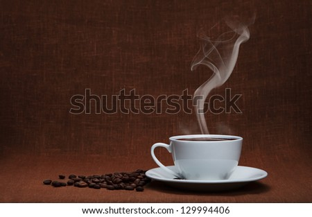 steaming coffee with beans and copy space - stock photo