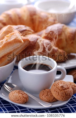 steaming espresso coffee in white cup for breakfast - stock photo