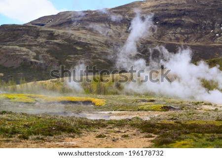 Steaming geothermal hot water Iceland - stock photo