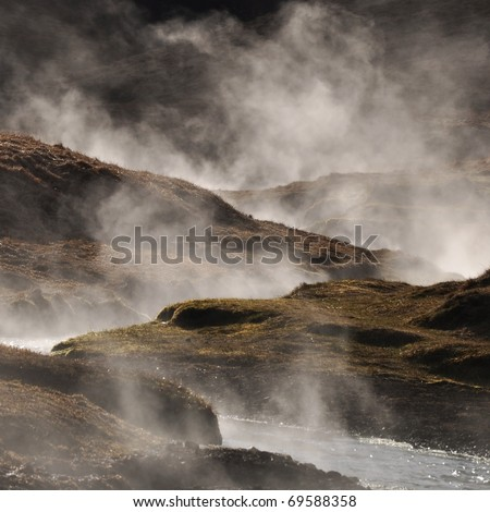 Steaming geothermal hot water, Iceland - stock photo