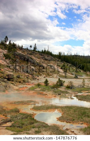 Steaming hot springs in Yellowstone National Park, Wyoming, USA. - stock photo