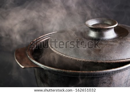 Steaming iron pot , cover opened - stock photo