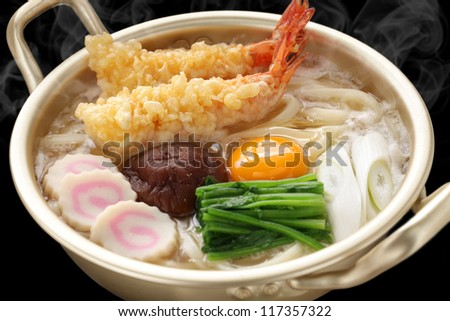 steaming nabeyaki udon, japanese hot pot noodles - stock photo