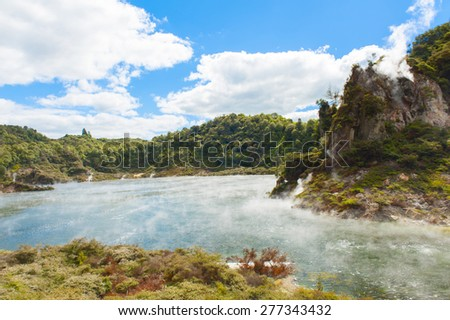 Steaming volcano nearFrying pan lake, the largest hot water spring in the world. Rotorua, Waimangu geothermal area, New Zealand - stock photo
