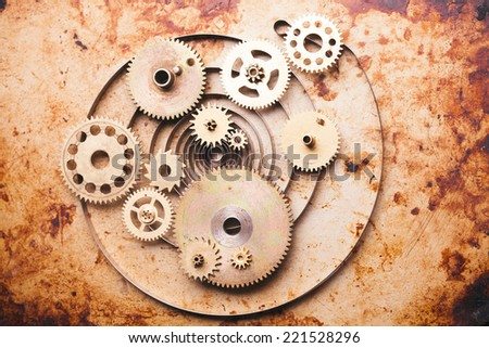 Steampunk background from mechanical clocks details over old metal background. Inside the clock, gears - stock photo