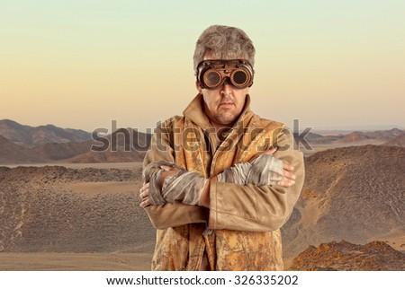 Steampunk man wearing glasses. Post-apocalypse fantasy - stock photo