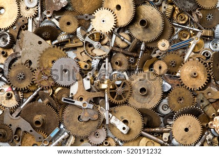 Steampunk mechanical equipment and mechanism background. Aged gears, hand clock parts. Shabby grunge scratch metal texture. Shallow depth of field, soft focus
