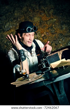 steampunk-styled financier working at the table with arithmometer - stock photo