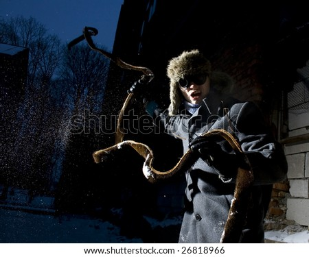 steampunker in industral scary place is attacking - stock photo