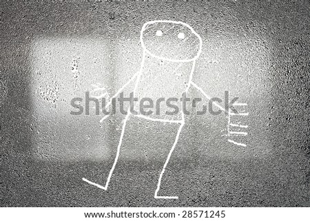 Steamy window with child's drawing - stock photo