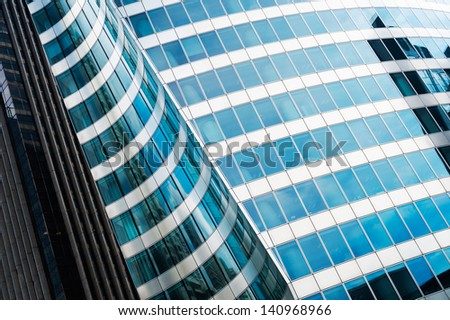 Steel and glass business background. Photo taken in La Defense, major business district near Paris, in France. - stock photo