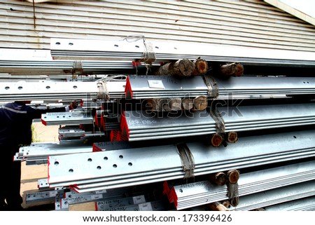 Steel angles bunch on the rack in warehouse before shipment