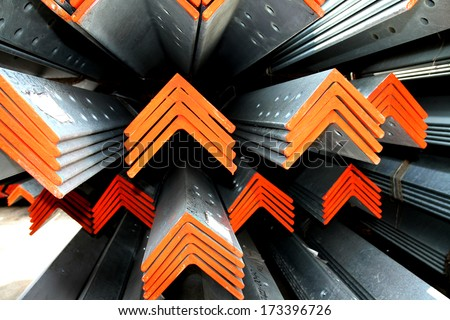 Steel angles bunch on the rack in warehouse before shipment  - stock photo