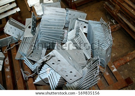 Steel angles & steel plates bunch in the wooden pallet - stock photo