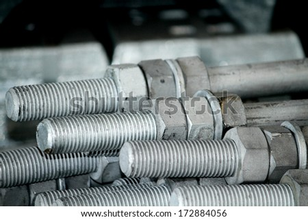 Steel bolts & nuts bunch in warehouse