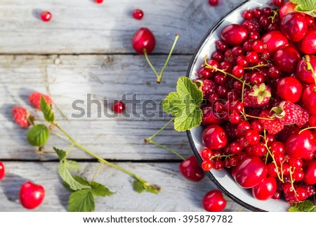 Steel bowl filled with the variety of fruit. - stock photo