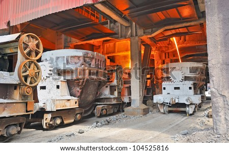 steel buckets to transport the molten metal - stock photo