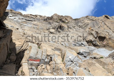 Steel cable from a via ferrata in a mountain rock face, Hohe Tauern Alps, Austria - stock photo