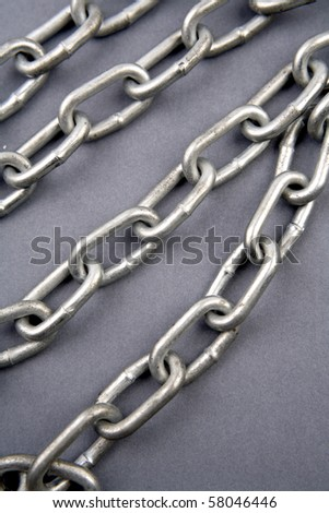 Steel chains on blue background