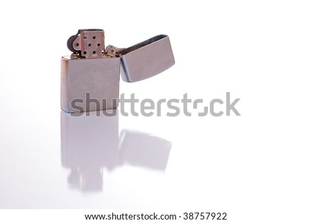 Steel cigarette lighter isolated on white background - stock photo
