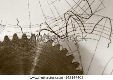 Steel cogwheel on drawing - stock photo