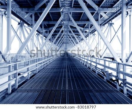 steel construction from under the bridge. - stock photo