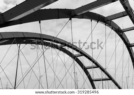 Steel construction of red bridge. Black and white  - stock photo