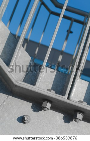 Steel construction; Part of external fire escape; Screw connections; Modern construction elements - stock photo