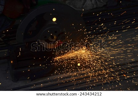Steel cutters are working with sparks