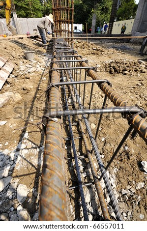 Steel deformed bars. Image shows the structure of cast concrete beams. Workers help each other harmoniously - stock photo