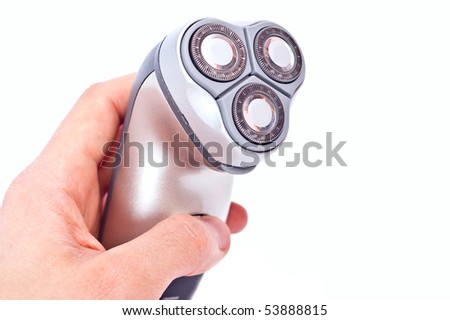 Steel electric razor in hand isolated on white - stock photo