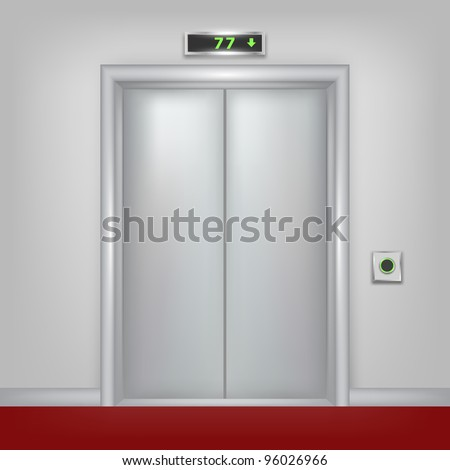 Steel elevator with closed doors.