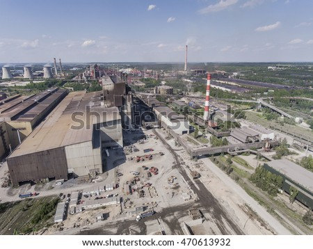 Steel factory with smokestacks at sunny day.Metallurgical plant. steelworks, iron works. Heavy industry in Europe.Air pollution from smokestacks, ecology problems. Industrial landscape.View from above.