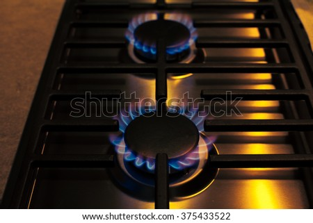 steel gas stove and blue gas fire flame - stock photo