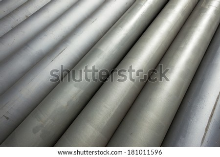 Steel Grey Pipes  Steel metal grey colored pipe lengths sections placed together on construction site