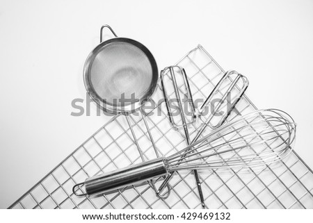steel grid for grill  Kitchen mixer  hand mixer and colander  isolated on white background. - stock photo