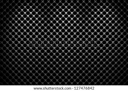 Steel grid with round holes and reflection on black background under the three vertical spot lights, abstract textured background