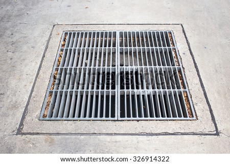 Steel Grill Sewer Cover or Manhole cover. - stock photo